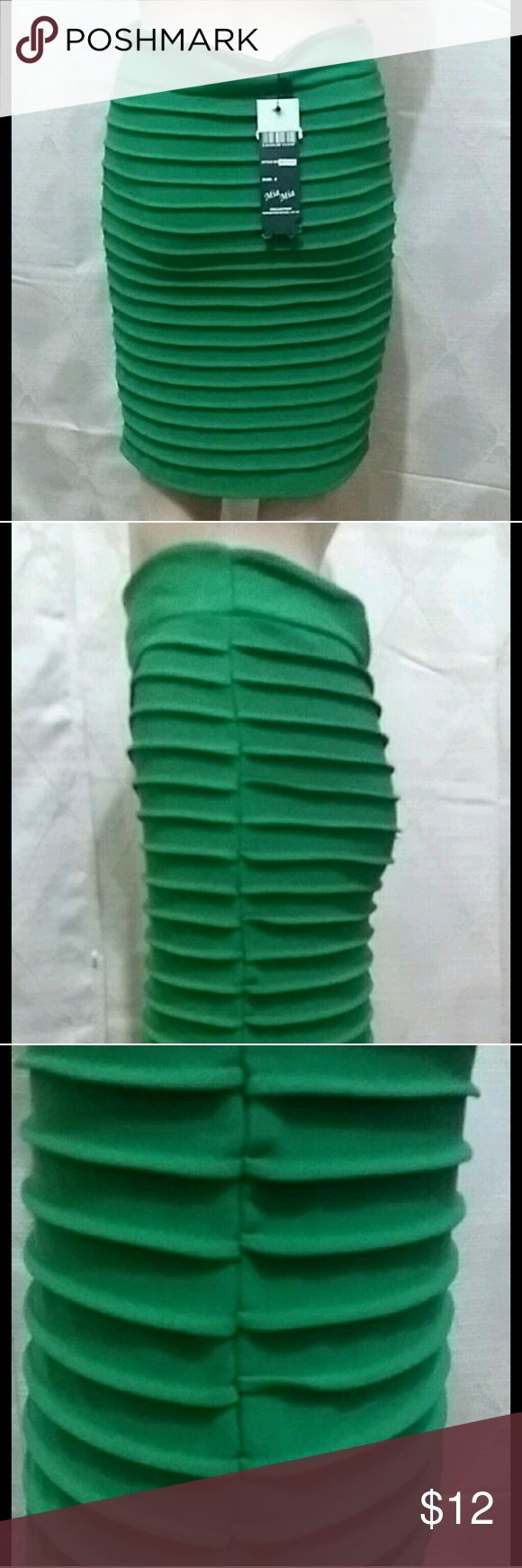 Green textured pencil skirt NWT Size small green pencil skirt with stretch and hidden zipper on the side. Too small I went up a size before I could wear half my closet. Skirts Pencil