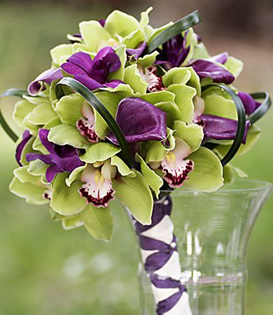 I really like this. It's not your usual and will match my colors. Bridal floral arrangement designed using purple calla lily, green & lily grass loops.