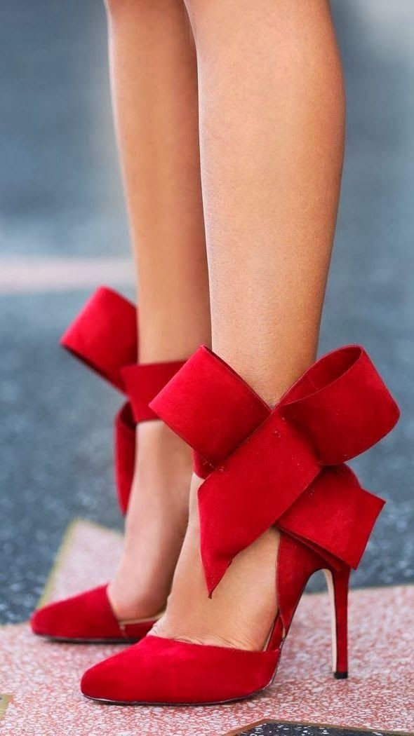 Stylish red high heels with ribbon; christmas time or with a black dress