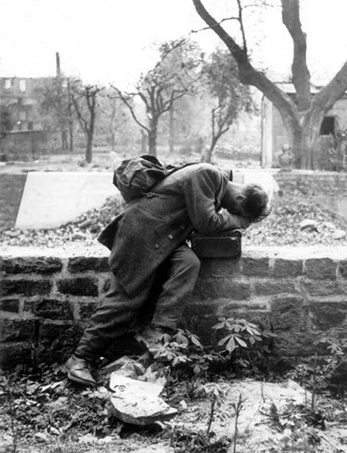 A German soldier returning to his home after WWII who just found out all his family was killed and his house gone due to the Allied air raids