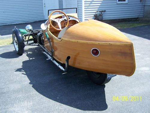 While i would not attempt to build a wood body trike , i did find the engine placement interesting in this one. I would like to know more about it if anyone has more info on it.