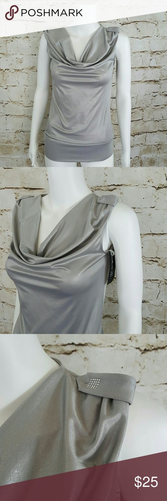 """NWT!! INC INTERNATIONAL CONCEPTS silver blouse Sparkly silver metallic top with drape v neck there is a weight attached to the neck to keep in place 17"""" across from armpit to armpit and 26"""" long from shoulder to hem in INC International Concepts Tops"""