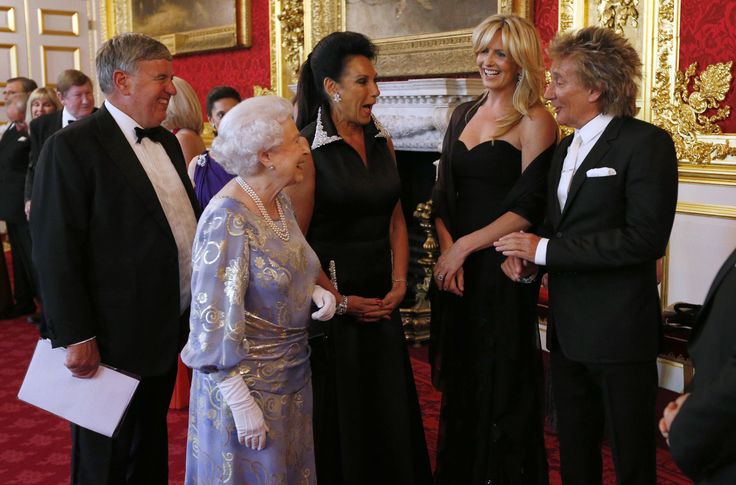 LONDON, UNITED KINGDOM - JUNE 3: Queen Elizabeth II greets Penny Lancaster (2nd R) and Rod Stewart (R) during a reception for the Royal National Institute for the Blind at St James Palace on June 3, 2013 in London, England. (Photo by Jonathan Brady - WPA Pool/Getty Images) via @AOL_Lifestyle Read more: http://www.aol.com/article/2016/10/13/queen-elizabeth-initially-told-not-to-marry-too-funny-prince-p/21582397/?a_dgi=aolshare_pinterest#slide=3031645