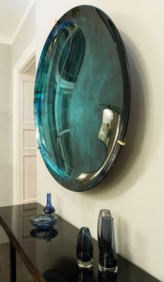 Mirror Ideas for your Home | concave green Mirror by Christophe Gaignon |www.bocadolobo.com | #luxuryfurniture #mirrorideas