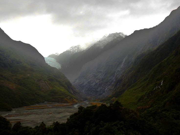 https://flic.kr/p/Ryadwn | 5886ex2  Franz Josef Glacier view | It was a very dreary overcast day, but we still hiked up to the vantage point to be able to view Franz Josef Glacier.     Franz Josef Glacier / Kā Roimata o Hine Hukatere is a 12 km (7.5 mi) long[1] temperate maritime glacier located in Westland Tai Poutini National Park on the West Coast of New Zealand's South Island. Together with the Fox Glacier 20 km (12 mi) to the south, and a third glacier, it descends from the Southern…