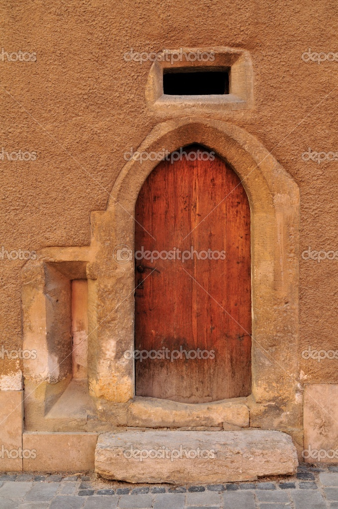 Very old wooden door of a building in the historic area of Sopron, Hungary