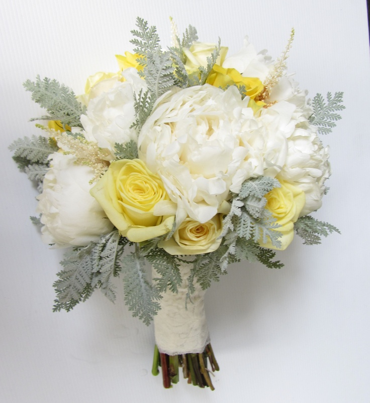 Charmed Flowers bouquet of Lemon & Bright Yellow roses and cream peonies with silver/grey foliage.