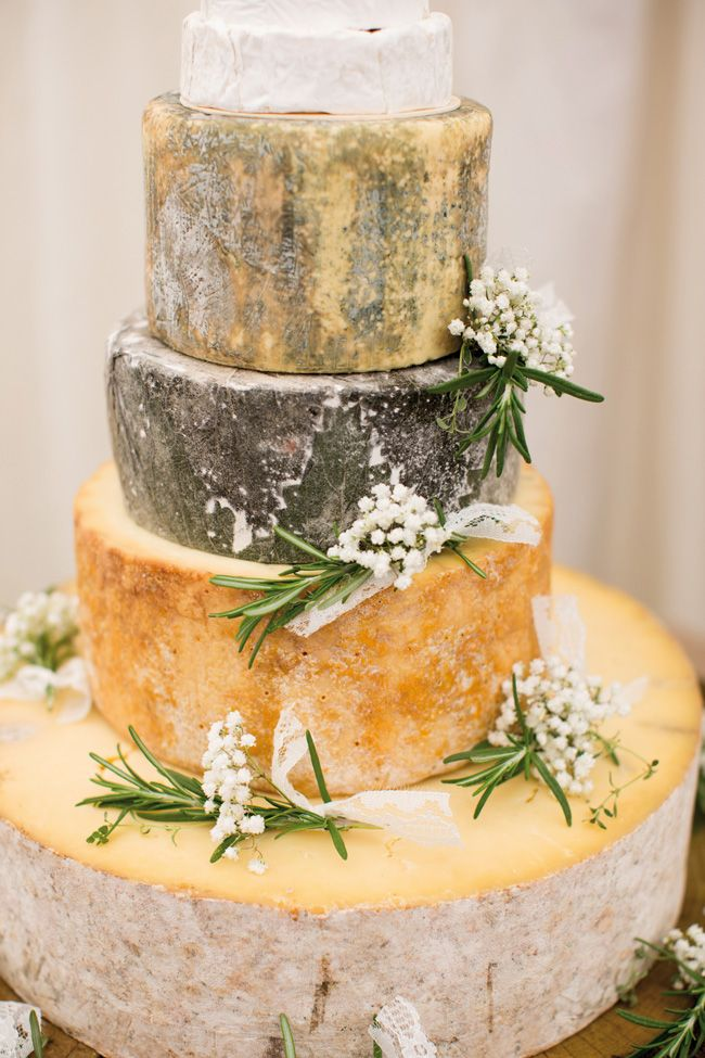 Rustic cheese wheels instead of a traditional wedding cake is a must at a festival wedding