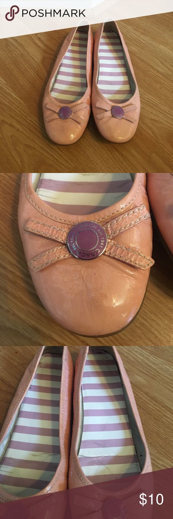 Baby pink and purple bow coach flats Coach flats with the coach button and bows on each of the feet. They are used and there's signs of cracking on the soles along with a nail polish stain on the bottom that can be gotten out. Coach Shoes Flats & Loafers