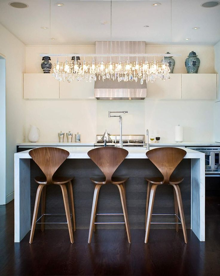 Kitchen With Contemporary Stools And Linear Chandelier