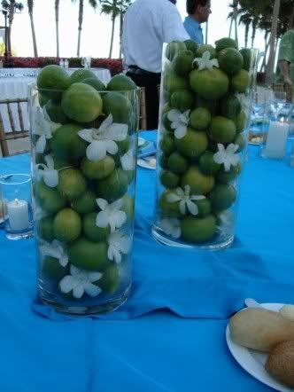 lime centerpieces w little white flowers  add a tied ribbon in white would be elegant