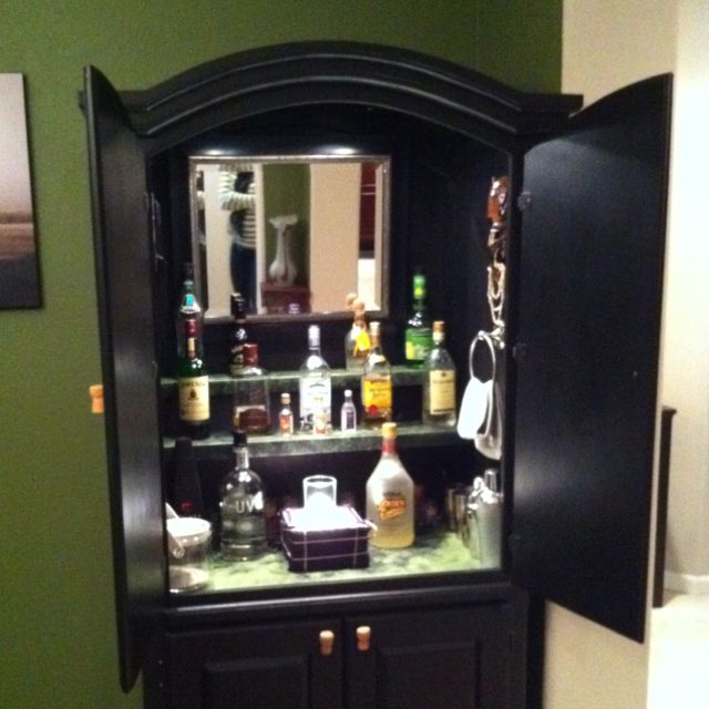 Turn A Old Armoire Into A Bar.