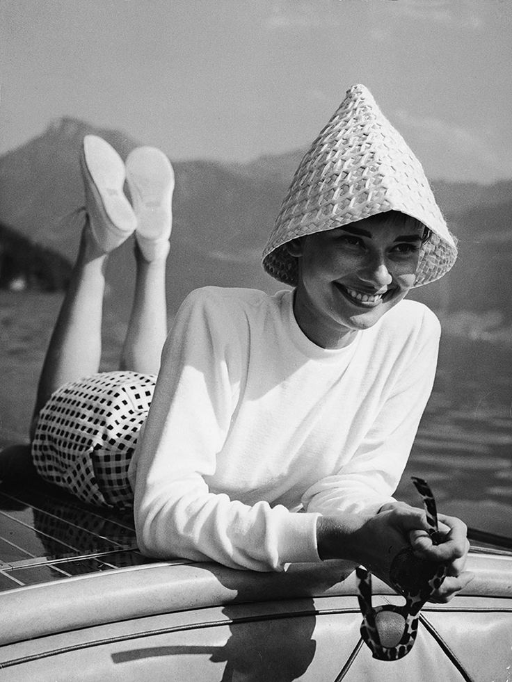 January 1950 | Nautical style for Audrey involves a fun hat and some seriously stylish shades. via @stylelist