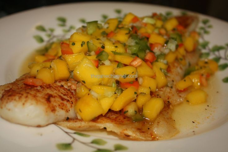 Baked Grouper Fillet with Mango Salsa A delightful dish to light up a gloomy winter day!  Hot seafood with cold mango salsa.  The mix of sweet mangoes and hot chilies salsa is both refreshing and f…