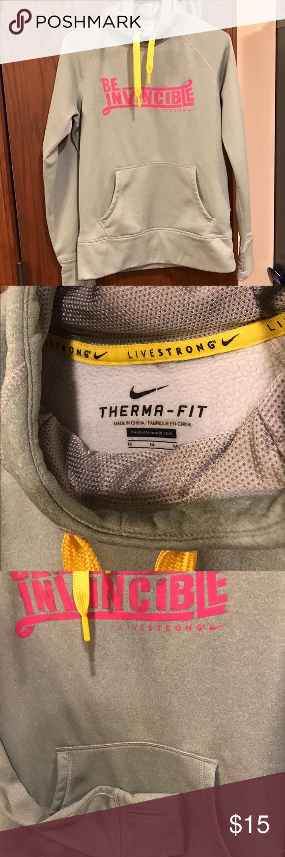 "Nike livestrong ""be invincible"" hoodie Fabric shows some wash wear. Still in good shape Nike Tops Sweatshirts & Hoodies"