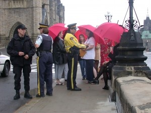 The Red Umbrellas Campaign on Parlaiment Hill June 2003 - inspiring women struggling to maintain the right  to take the nutritional supplement that had given them their lives back. For more info on the #supplement itself, please go http://qfamilyhealth.com