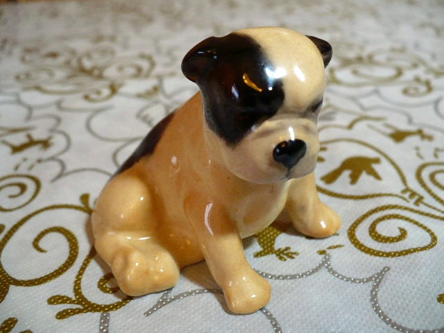 """In cream and brown colors this small bone china bulldog  is marked K2 and was made by Royal Doulton. The most desirable Royal Doulton breed of dog is by far the bulldog. During WWI the bulldog symbolized the dogged determination of the British people and is now regarded as the country's national animal.   The mark implies c 1930+. ( I believe this figurine was issued between 1931 -1977).  He measures 1 7/8"""" high and 2 1/8"""" long. $67.50  http://www.etsy.com/shop/VintageatElsiesPlace"""