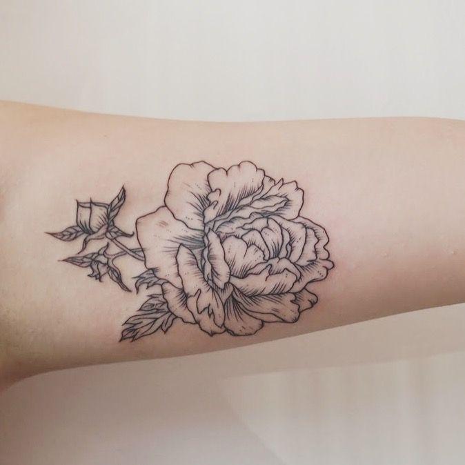 Inner bicep peony tattoo
