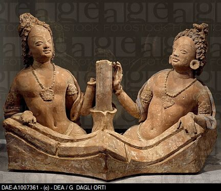 Two king-snakes coming out of a tub, terracotta statue from the Fondukistan monastery, Ghorband Valley, Afghanistan. Afghan Civilisation, 7th century....