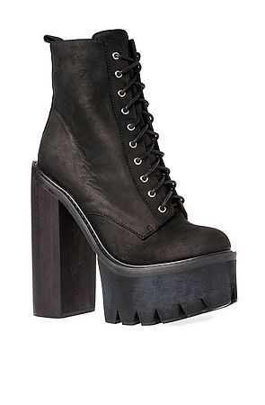 The Syndicate Boot in Black by Jeffrey Campbell. Keep the rest of your outfit simple to let these babies pop. $225
