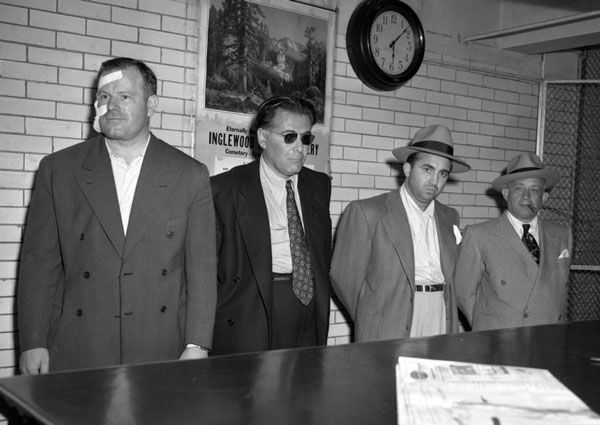 Cohen (third from left) with Jimmy Rist, Sol Davis, and Mike Howard, being booked on suspicion of murder in 1948. Courtesy of the Los Angele...