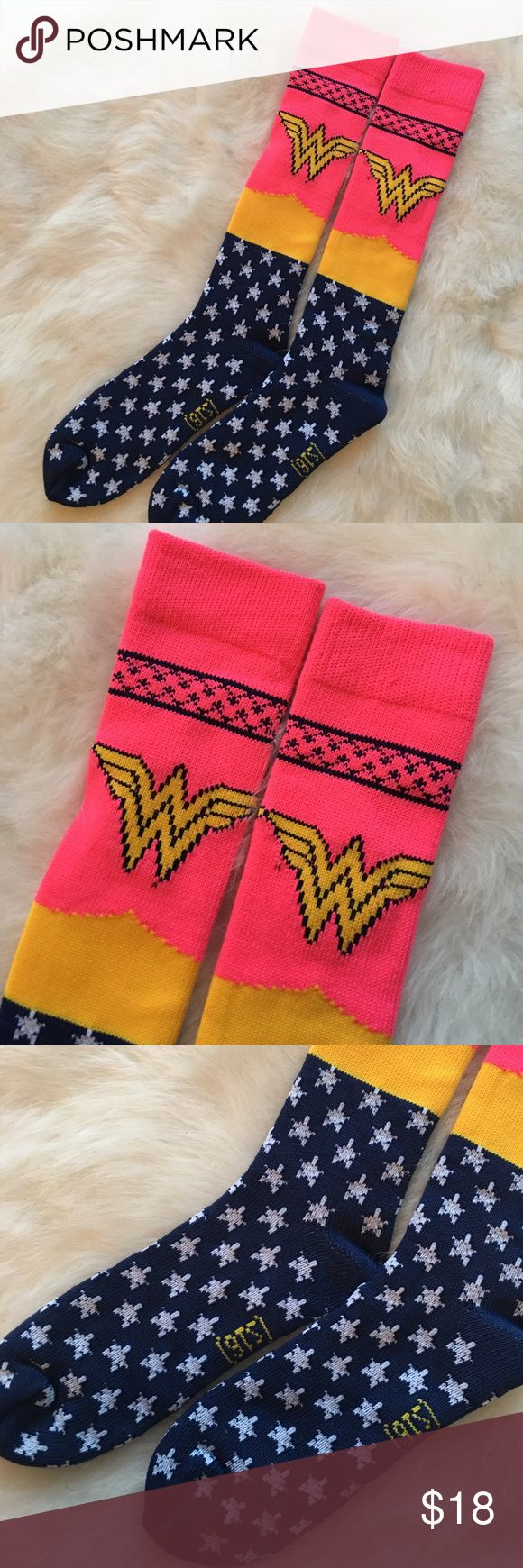 D.C. Comics Women's Knee High Wonder Woman Socks Knee high socks for all you ✨Wonder Women✨ out there. Pair them with your favorite shorts for Festival Season, or a pair of workout spandex/shorts during your next SoulCycle or Spin Class. So so cute. Bright and bold colors. Never worn. Taken out of package, never even tried on. Stored and shipped from smoke and pet free home  DC Comics Accessories Hosiery & Socks