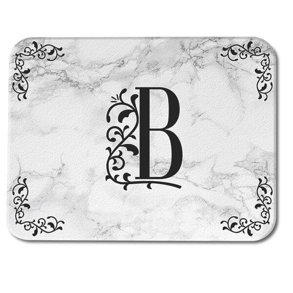Being outlandish will draw attention for a while- but you know that truly timeless things don't have to try so hard. Capture effortless, Victorian-inspired elegance with this Marble-printed Ornate Glass Cutting Board, which features your custom monogram in the center.