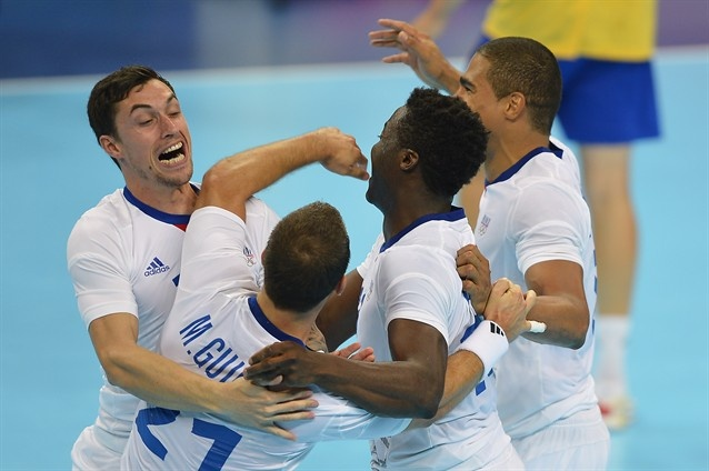 France's players celebrate after winning the men's gold medal handball match between Sweden and France of the London 2012 Olympics Games. Add Around The Rings on www.Twitter.com/AroundTheRings & www.Facebook.com/AroundTheRings for the latest info on the #Olympics.