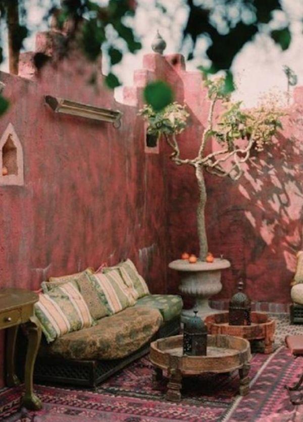 Behind the wall... pink eclectic patio pergola hangout sofa rooftop terrace backyard secret garden lanterns sofa tree