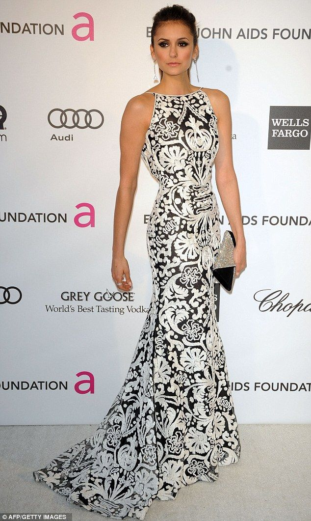 Nina Dobrev wore a Naeem Kahn dress with Barbara Bui shoes, Swarovski clutch, and Chopard jewelry.