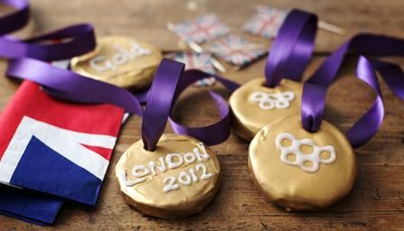 Olympic Gold Medal    Ingredients    For the base:  120g/4oz plain flour  50g/1oz caster sugar  120g/4oz butter  50g/1oz semolina  For the topping:  24 pieces butter fudge sweets  75g/2oz dark chocolate  gold luster