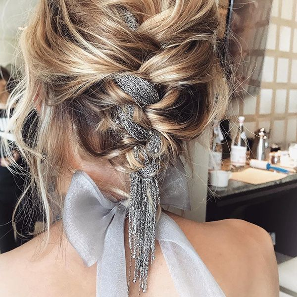 Vanessa Kirby - For this year's SAG Awards, celebrity hairstylist Adir Abergel wove a silver chain into The Crown actress' braided updo. The links dropped just below her neckline, mimicking the ends of her hair.