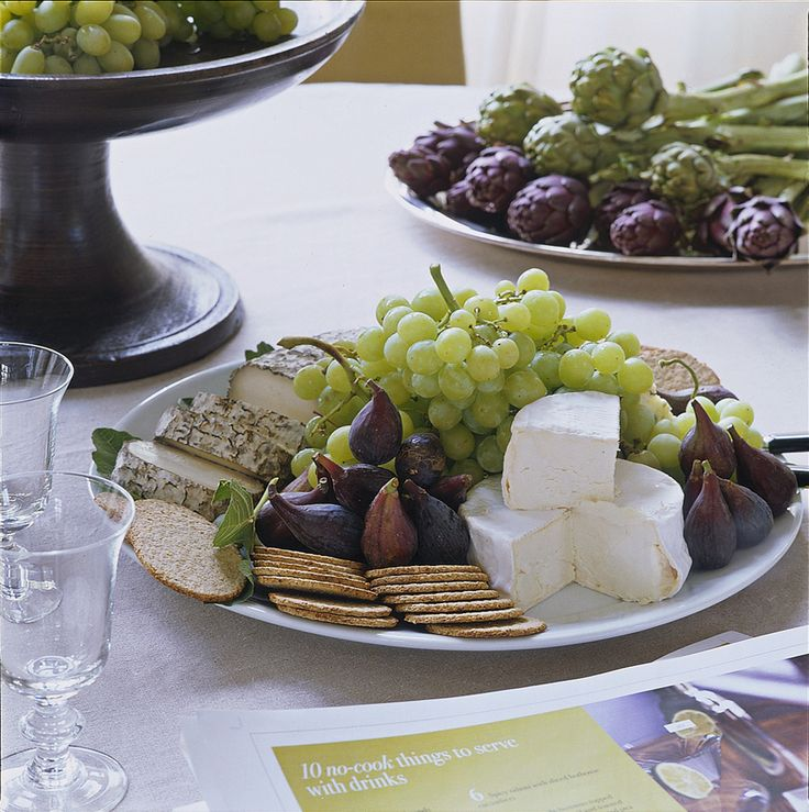 The cook lays out grapes, figs, crackers, and cheese. So basic, so Ina!   - HouseBeautiful.com