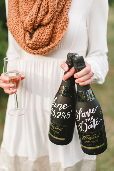 Engagement announcement with a unique bottle of champagne: http://www.stylemepretty.com/2016/09/24/engagement-announcements-you-havent-seen-a-million-times-on-facebook/