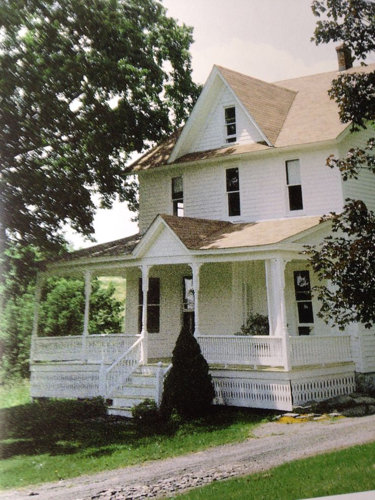 Front porch like this. Already have the middle peak. White farmhouse