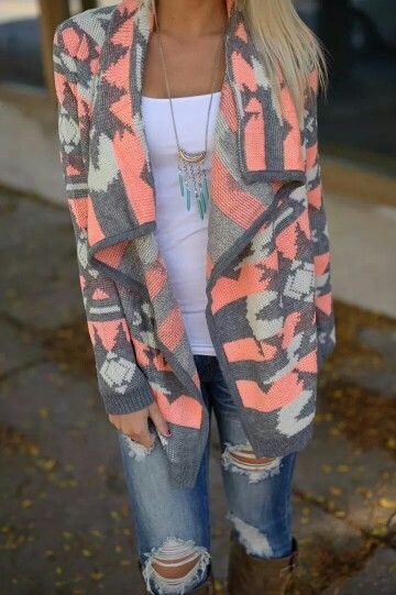 Love the colors on this sweater.. perfect combo with the ripped jeans