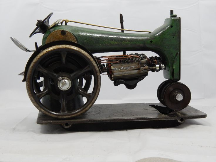 Tractor is made out of a 1912 G Series Singer Sewing Machine. The Detail in this piece is amazing. $250 www.whenheatmeetsrust.com and like us on Facebook https://www.facebook.com/WhenHeatMeetsRust