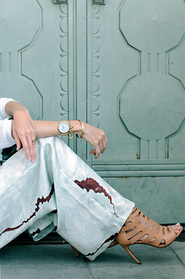 Designer Sarah Sherman Samuel wears the Larsson & Jennings CM | Gold watch.