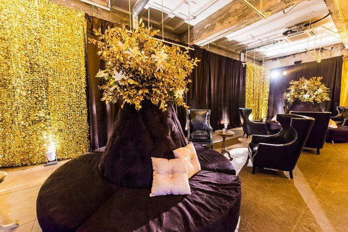 The downstairs space was decorated in tones of gold and black, used to effect in…