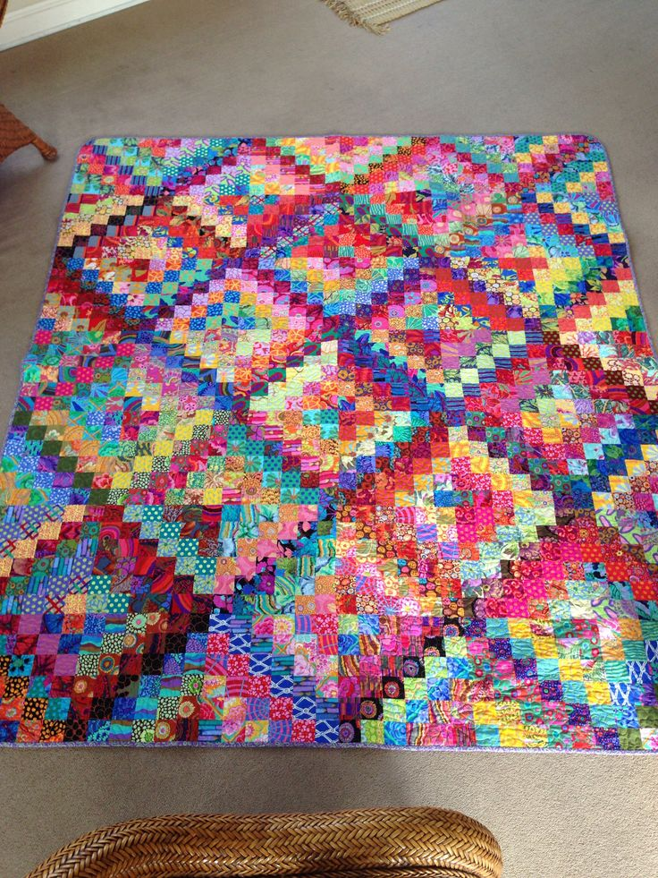My (Cyndi Widman) Kaffe Fassett Scrappy Trips (pattern by Bonnie Hunter). Quilted from the back. So fun to make, I hated to finish.