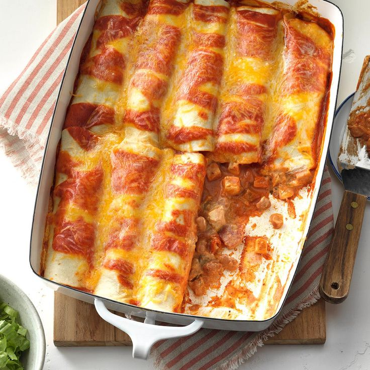 Simple Chicken Enchiladas Recipe -This recipe is so quick and easy, and I always receive a ton of compliments. It quickly becomes a favorite of friends whenever I share the recipe. Modify the spiciness with the intensity of the salsa and the green chilis to suit your taste. —Kristi Black, Harrison Township, Michigan