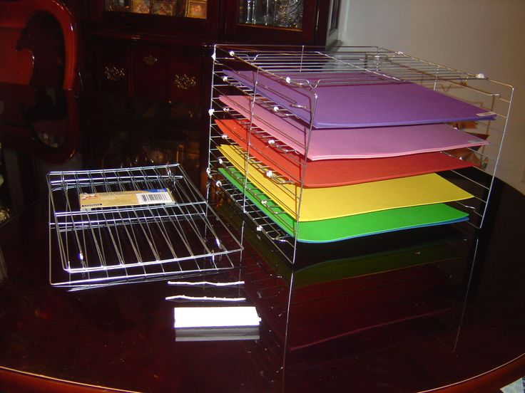 12 x 12 paper organizer using cooling racks from Dollar store and twist ties (yes, from garbage bags or bread bags). The racks are two for a dollar. I used 9 racks and tied them up with the twists. It worked well since I didn't have to use pliers or other tools.  Total cost was $5.00  rather that thirty or forty for an organizer in crafts stores. Make sure to tie and twist well several times. After several ties and twists, you may need to trim the end of the ties (in case the ties are too…