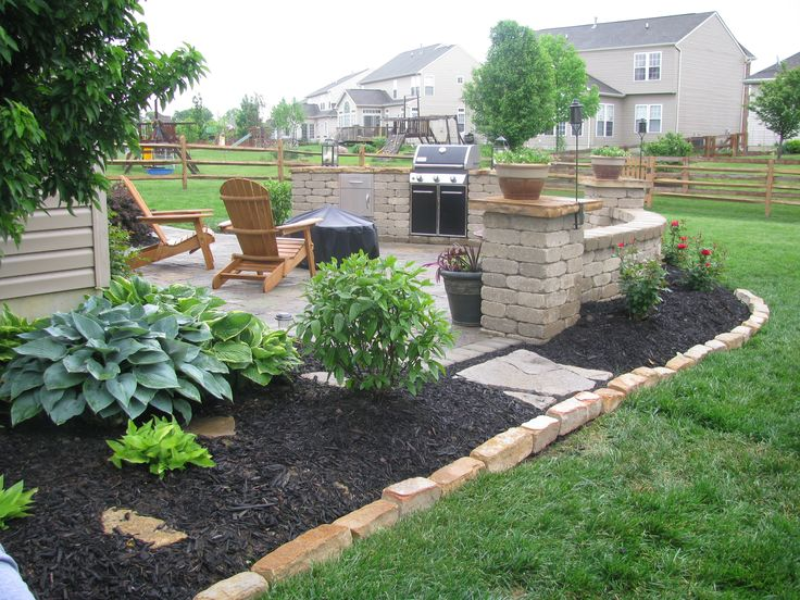 Landscaped Beds Around An Outdoor Kitchen Area 400 x 300