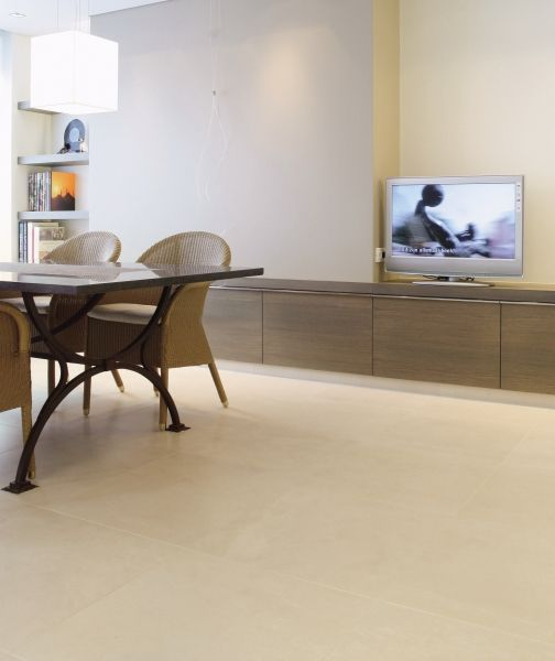 The flooring of the living room of this flat in Oostende has been tiled using Elegance Via Condotti 59.4x59.4 cm. The linear and clean-cut design of the surfaces and the furniture, all modulated using light-coloured shades from hazelnut to beige and cream, has been coordinated to create an area which is distinguished by the rules of minimalism. Black is used along the lower part of the fire place at the level of the combustion chamber and is also used in the black leather of the sofa and…