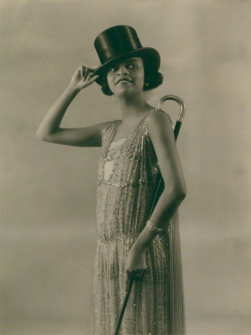 """One of the earliest Black superstars, singer Florence Mills (1896-1927) on August 1, 1923 in Dover Street to Dixie at the London Pavilion. Best known as the lead in the first all-black Broadway musical, Shuffle Along"""" in 1921, Ms. Millssudden death in 1927 at the height of her popularity devastated her friends and fans in the United States and Europe. An estimated 150,000 people lined the streets of Harlem to mourn her passing. Photo: Bassano/National Portrait Gallery, London."""