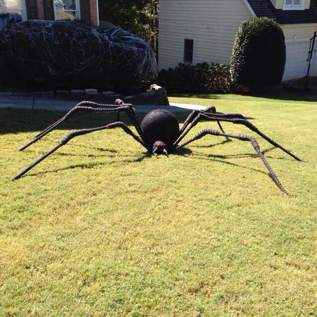 Giant spider made from pvc pipe, exercise ball and kid bicycle helmet. Great halloween decor for outside