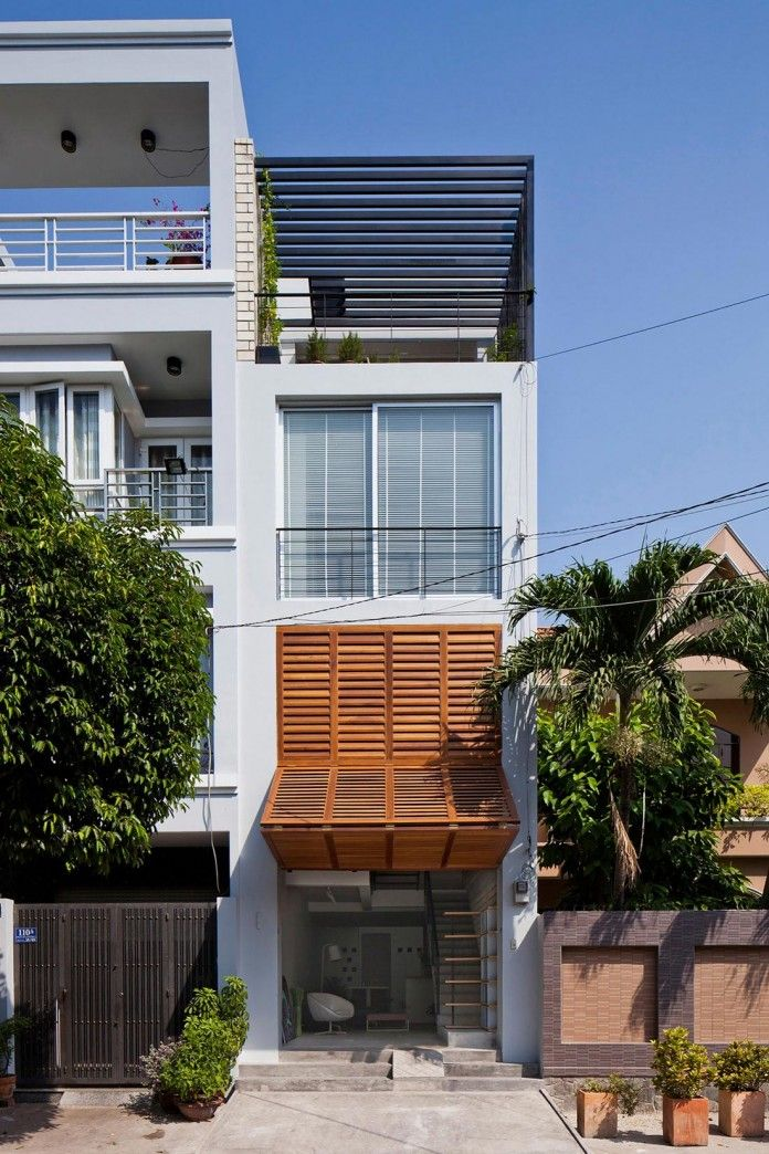 narrow townhouse in vietnam by MM features