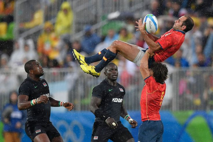 Spain's Pablo Feijoo catches the ball in the men's rugby sevens match between…