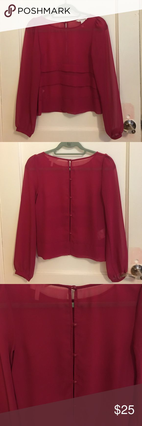 BCBGeneration Red Berry sheer top LIKE NEW, WORN ONLY ONCE. BCBGeneration sheer top in Red Berry. Size XS. Cute tiered front, button up back, cuffed sleeves, slightly puffed shoulders. BCBGeneration Tops Blouses