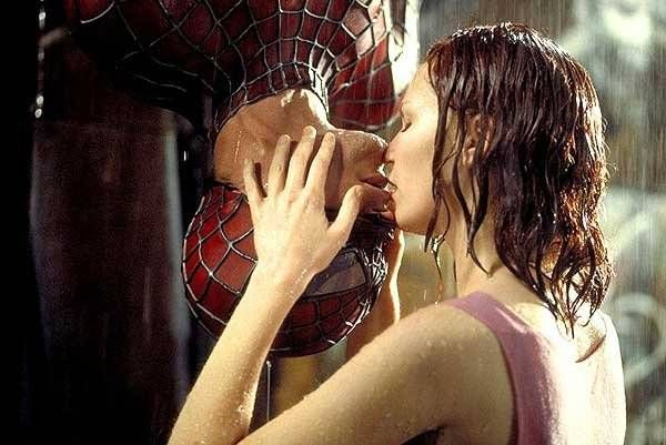 Kirsten Dunst and Tobey McGuire in Spiderman. Love the upside down kiss.